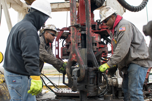 men working together for oil drilling