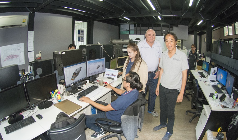 Managing Director Tavipol Hemangkorn on right, also Australian Project Mamager with design coordinator Khun Ah (standing) and draftsman Khun Chai at computer.