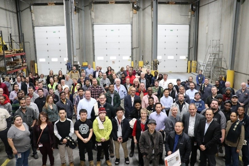 Cummins employees celebrate the 25,000th AMMPS unit produced in the Fridley, Minnesota plant.