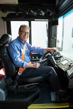 U.S. Sen. Mike Braun behind the wheel of an electric bus powered by Cummins.