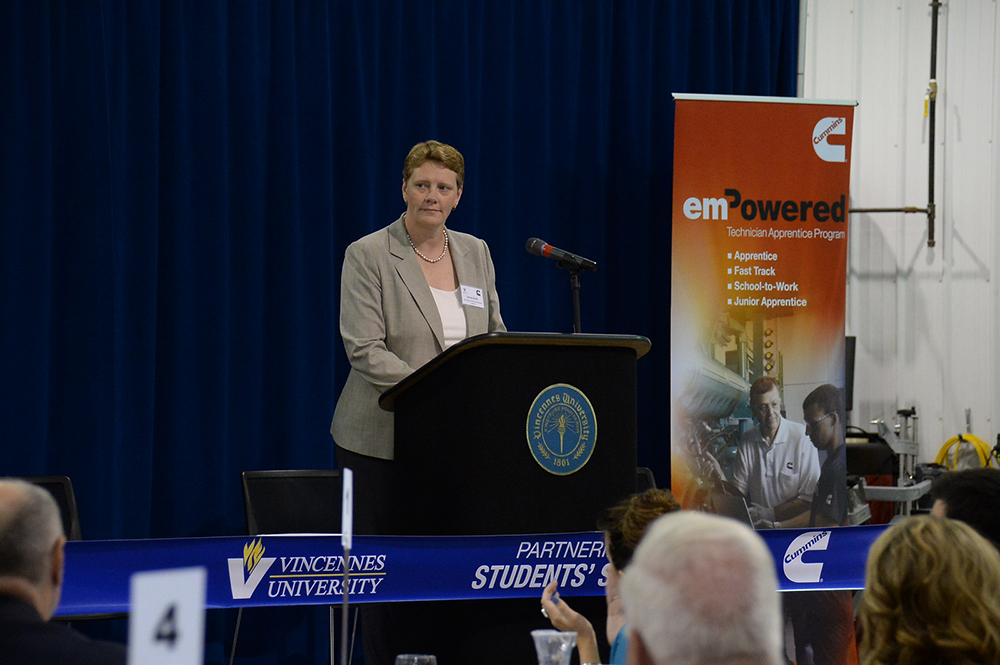 Jenny Bush, Executive Managing Director – North America Distribution, Cummins Inc., addresses students, faculty, media and local officials at Vincennes University as part of the Cummins/VU Technical Apprentice Program.