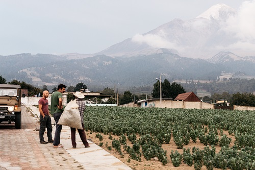 Stuart and Ploog talk to a local resident on their trip with Pico de Orizaba in the background.