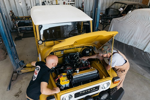 The Clean Cruiser team works on one of its vehicles before the big trip.