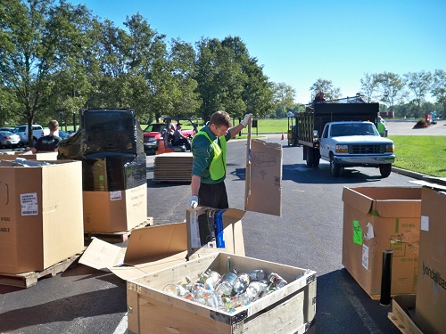 Employees gather recyclables at a previous Communitywide Recycle Day at the Cummins Engine Plant.