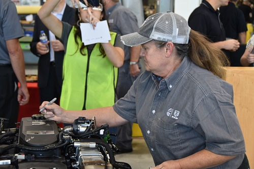 Debra Wilson leaves her mark on Cummins 3 millionth engine for RAM.