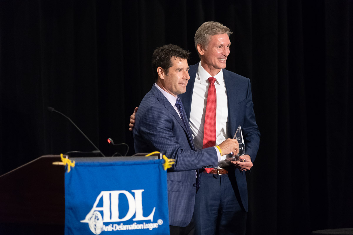 Tom Linebarger accepts award for Man of the Year from the Anti-Defamation League