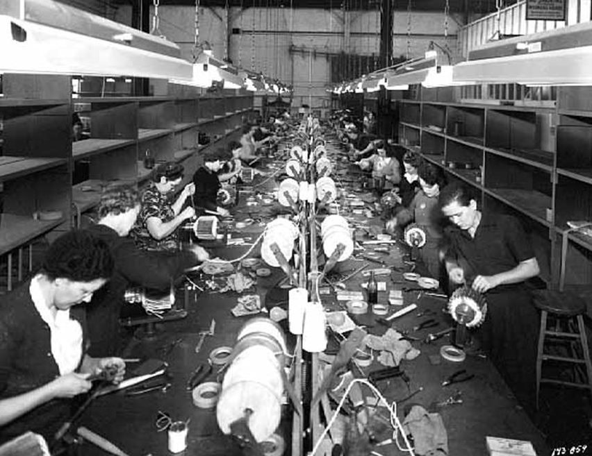 Employees of Onan Corporation winding armature at University Plant, Minnesota, U.S. in 1942 , during World War II.