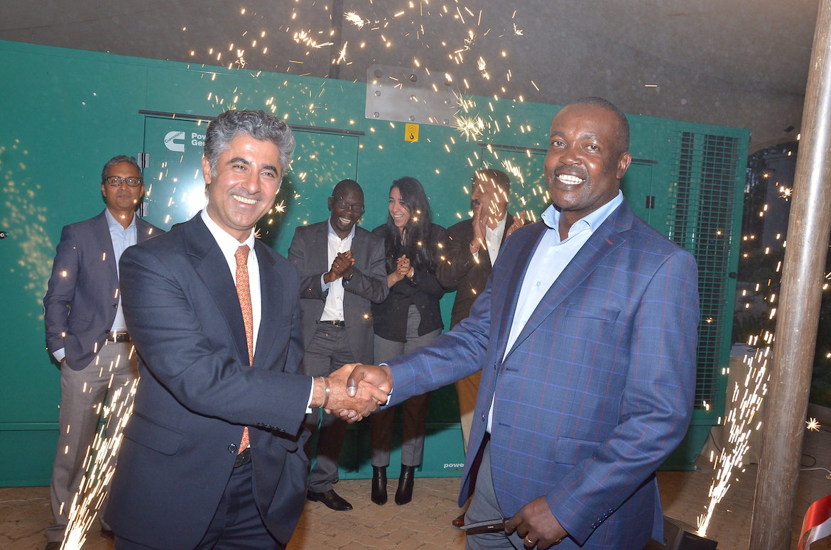 Car & General Group CEO Vijay Gidoomal (left) celebrates the launch with Colonel Olwende of Kenya Defence Forces