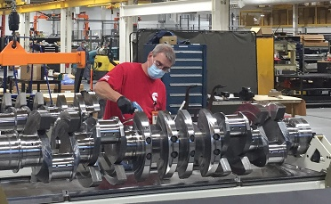 A Seymour Engine Plant employee at work