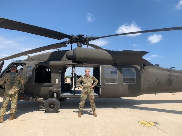 Lindsey with a helicopter at National Guard training