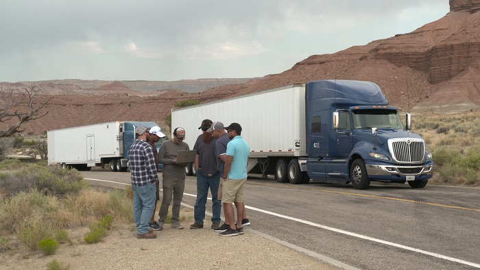 Cummins Engineer Trent Berardi (center, with laptop), talks to X12 team members during a stop in central Utah (U.S.A.) earlier this year.