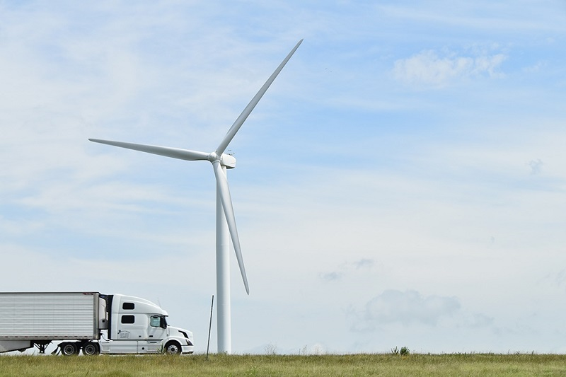 Truck drives by a turbine at Meadow Lake
