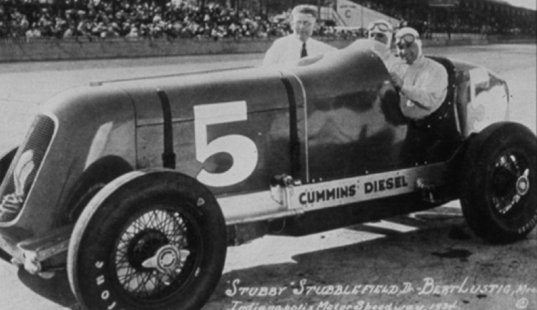 "Clessie Cummins poses with driver ""Stubby"" Stubblefield and mechanic Bert Lustig"