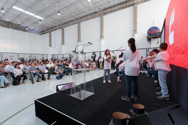 Students help celebrate the renovation and expansion of the Victor Civita school in Guarulhos, Brazil, along with a host of neighborhood residents, government officials and Cummins employees.