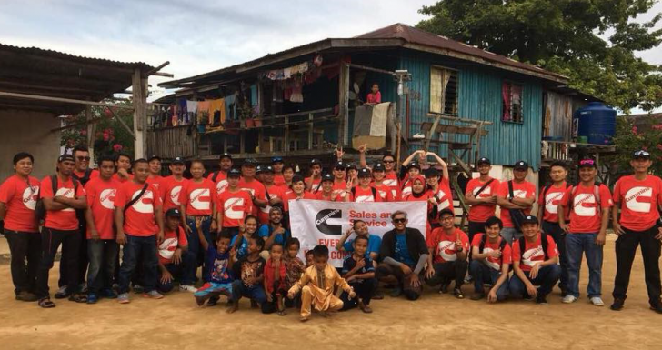 Cummins employees in Malaysia celebrate bringing solar lighting to a village without electricity.