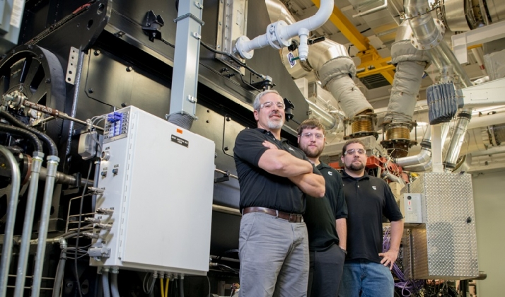 Cummins teams like this one in Seymour, Indiana (USA) are using regenerative dynamometers (behind them) to capture the energy generated testing engines to help power to the company's plants.