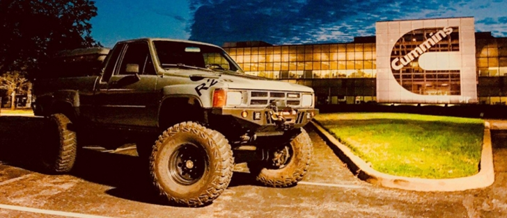 Repowered TAV Toyota Xtra Cab in front of Cummins building