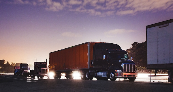 heavy duty truck fleet at sunrise