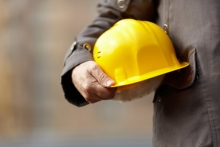 worker holding hard hat
