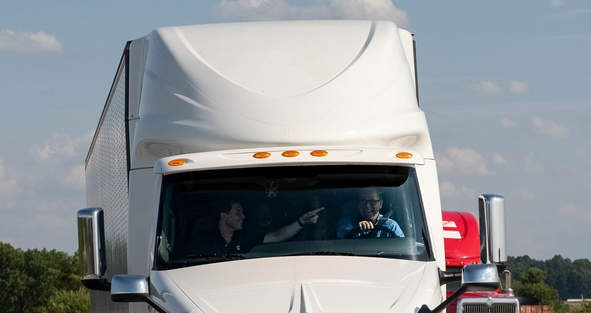 U.S. Sen. Mike Braun takes the wheel of a tractor-trailer powered by a Cummins X15 engine.