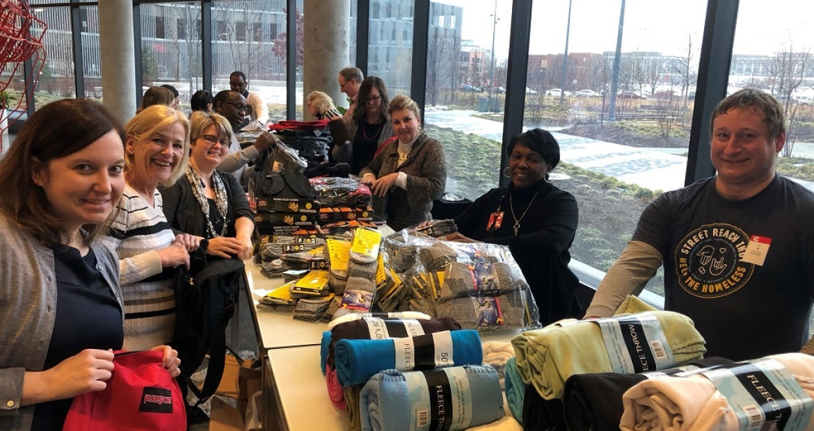 Volunteers assemble winter kits for the homeless in the lobby of Cummins' Distribution Business Headquarters on the east side of Indianapolis.