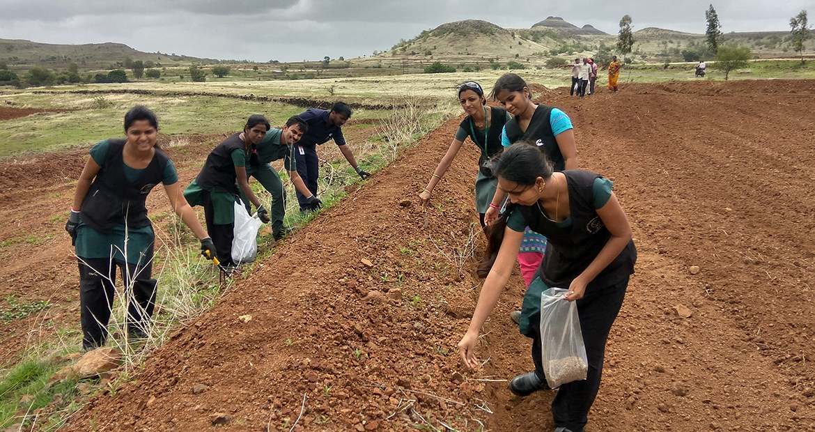 Cummins employees in Maharashtra, India, help build bunds to capture water.