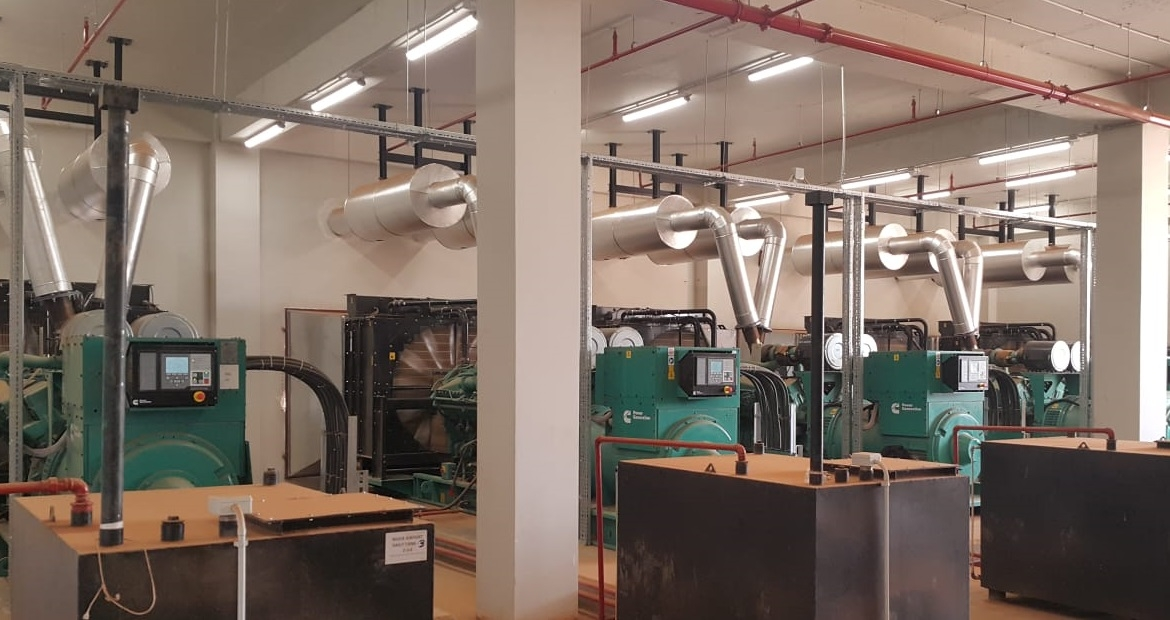 Five units of Cummins C1675D5A 0.4 kV generator sets are synchronized at 21 kV via step-up transformers.