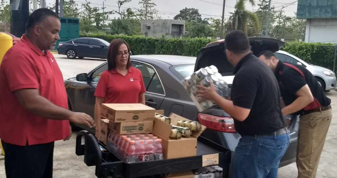Cummins employees in Puerto Rico unload supplies to keep the branch going over long hours.