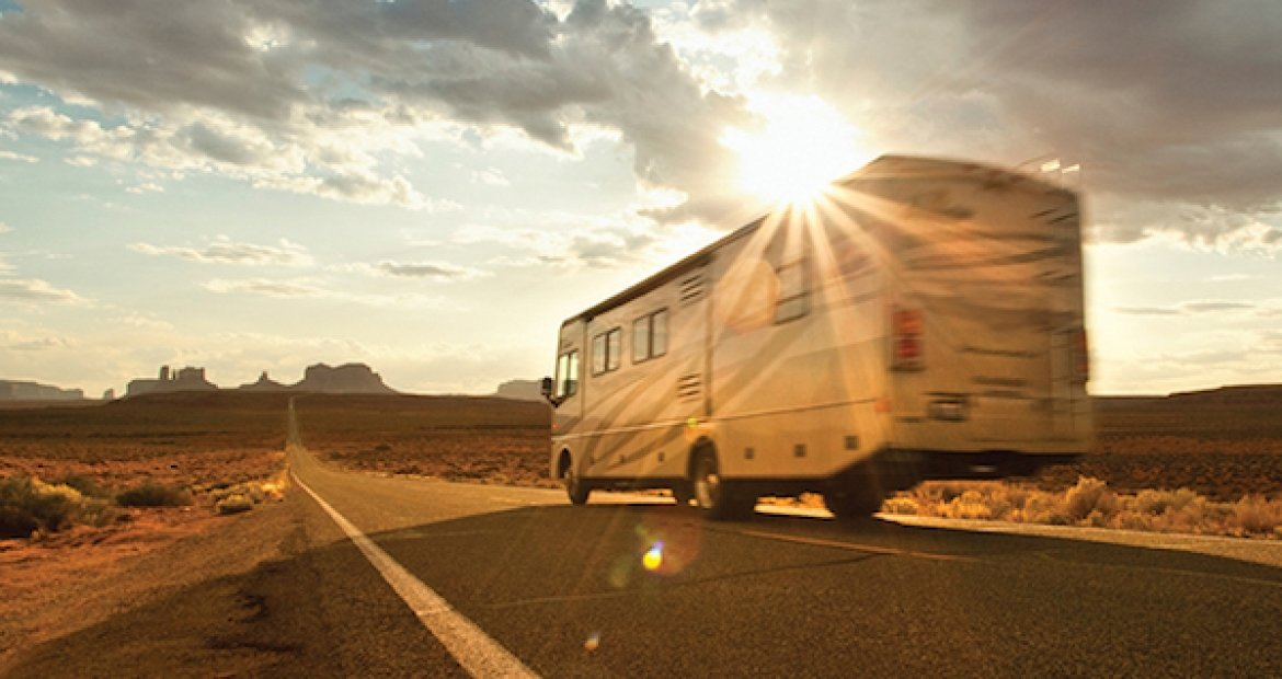 rv driving on open desert road