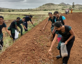 Cummins employees work on a grass-seeding project to help a community conserve water in India. This photo was taken prior to the COVID-19 pandemic.