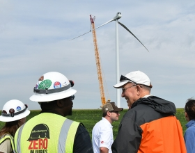 Visitors to the Meadow Lake Wind Farm in northwest Indiana look at one of the first wind turbines to go up at an expansion Cummins is supporting through a Virtual Power Purchase Agreement. When complete in early 2019, the expansion will include more than 50 wind turbines and a capital investment of about $340 million.