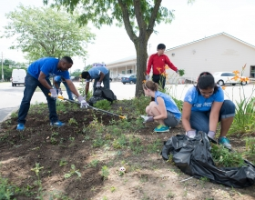 Cummins employees work on a cleanup day sponsored by the United Way.