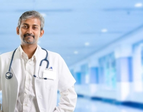 Male doctor standing in health facility