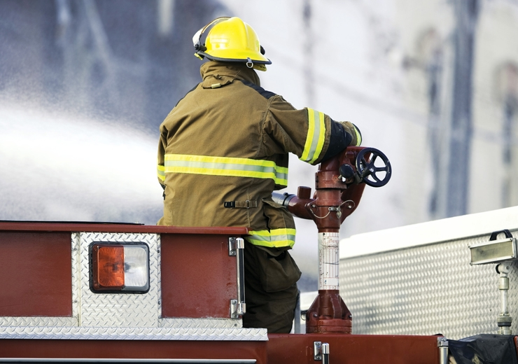 fire fighter extinguishing fire