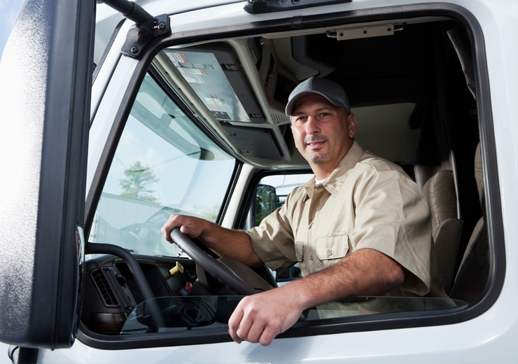 driver sitting in heavy-duty truck cab