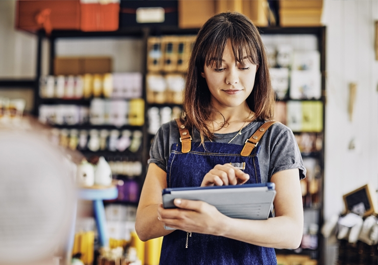 woman in business checking things off a list