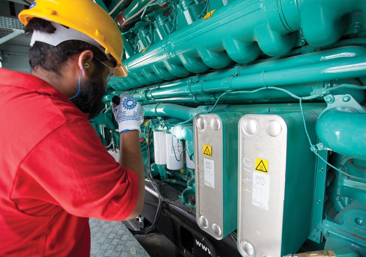 performing maintenance inspection on generator engine
