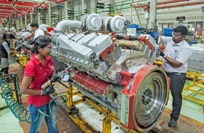 india workers engine assembly line