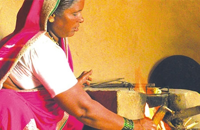 indian woman stoking fire